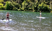 Paddle boarding the river